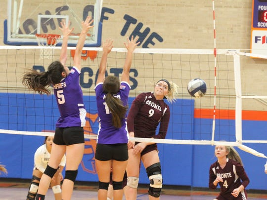 Bronte High School's Alyssa Sallee (9) helped lead the Lady Longhorns to a three-set sweep against Marfa in the Region I-1A Tournament semifinals at Babe Didrikson Gym on the Central campus on Friday, Nov. 10, 2017.