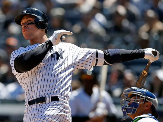 Apr 21, 2018; Bronx, NY, USA; New York Yankees right fielder Aaron Judge (99) watches a two-run home run against the Toronto Blue Jays during the third inning at Yankee Stadium.