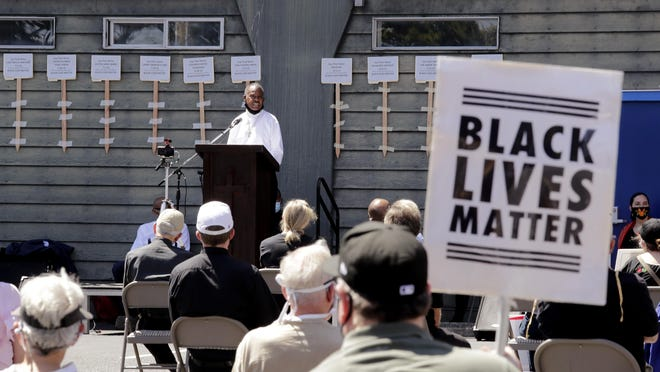 Deacon Joseph Conner speaks at an outdoor prayer vigil for racial justice at Immaculate Conception Catholic Church Sunday, July 19, 2020, in Seattle. The vigil follows ongoing protests over the death of George Floyd, a Black man who died in police custody in Minneapolis.
