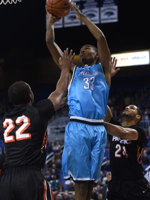 Josh Hall puts up a layup against Pacific.