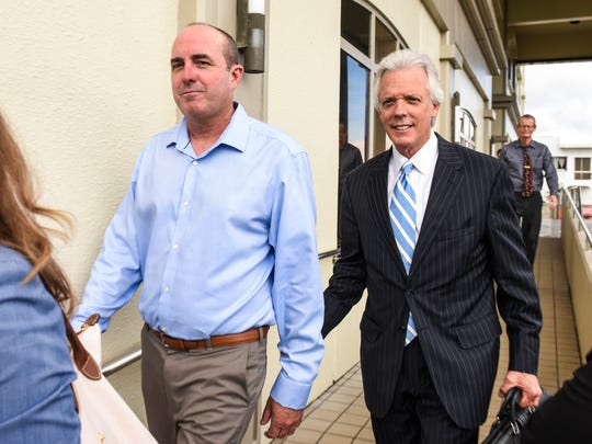 Hansen Helicopter Inc. owner John D. Walker, left, is escorted from the District Court of Guam by his attorney, Mack Martin, after his initial appearance before the court on Friday, June 8, 2018.