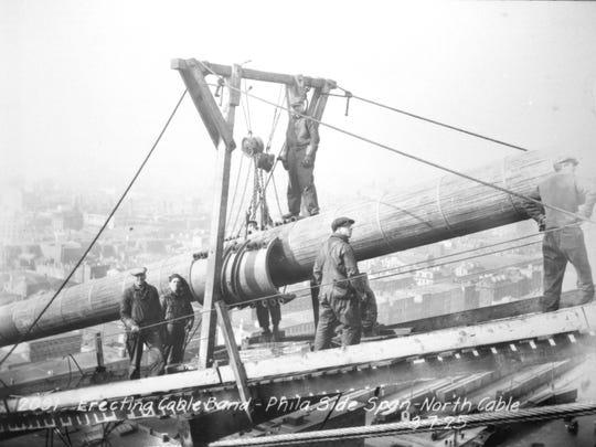 Workers hang cable in building the Ben Franklin Bridge between Camden and Philadelphia in 1926. It was first called the Delaware River Bridge.