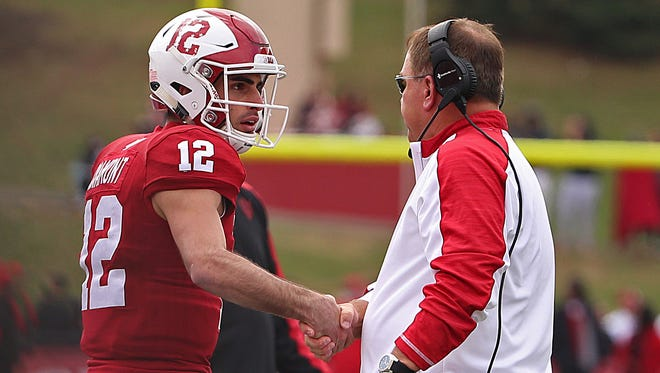 Indiana Hoosiers quarterback Zander Diamont (12) shakes hands with Indiana Hoosiers head coach Kevin Wilson after a touchdown during first half action of the Oaken Bucket game between Purdue and Indiana at Memorial Stadium, Bloomington, Ind., Saturday, Nov. 26, 2016.