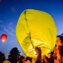 A sky lantern is lit during a memorial ceremony in this September 2014 LSJ file photo. A state rep wants to ban sky lanterns.