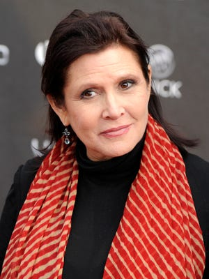 In this Thursday, April 7, 2011 file photo, Carrie Fisher arrives at the 2011 NewNowNext Awards in Los Angeles. On Tuesday, Dec. 27, 2016, a publicist said Fisher has died at the age of 60. (AP Photo/Chris Pizzello, File)
