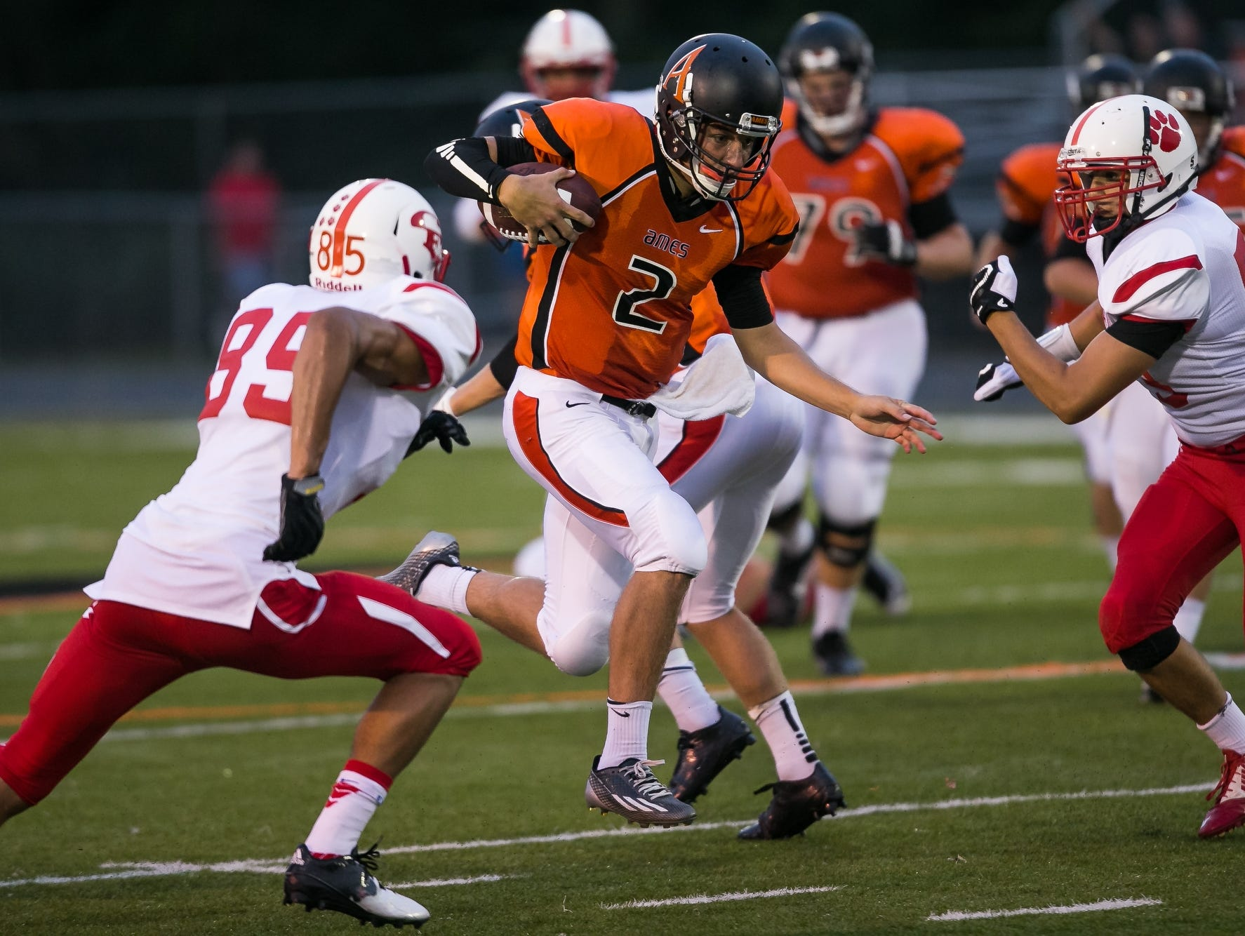 Ames' Ethan Hahn rushes during their game against Cedar Falls at Ames High School on Friday, Sept. 4, 2015.