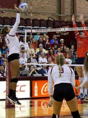 Florida State senior outside hitter Natasha Calkins goes for a kill during the fifth set of the Seminoles victory over Auburn.
