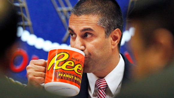 Federal Communications Commission (FCC) Chairman Ajit Pai takes a drink from a mug during an FCC meeting where the FCC voted on net neutrality, Dec. 14, 2017, in Washington.