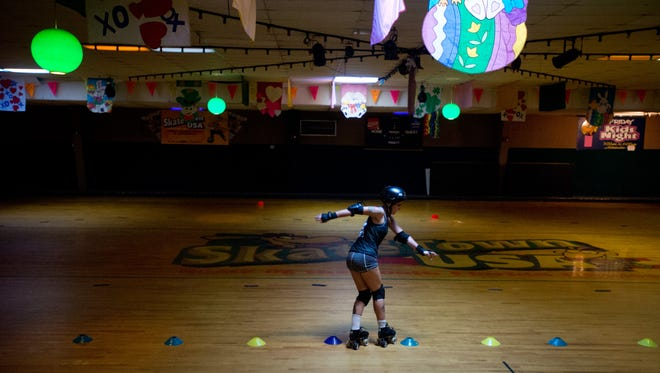 """Alli """"Big Al"""" Hammock, of Fort Pierce, runs a drill during a South Florida Roller Girls rolled derby practice Tuesday, May 16, 2017, at Skatetown USA in Fort Pierce. """"One of my friends from high school wanted to try it, and she didn't want to do it by herself,"""" Hammock said. """"I never played sports, but I said 'whatever, I'll try it,' and now she doesn't play anymore, and I'm still here because I love it,"""" she said. Financial woes at the longtime establishment could force the rink to close."""