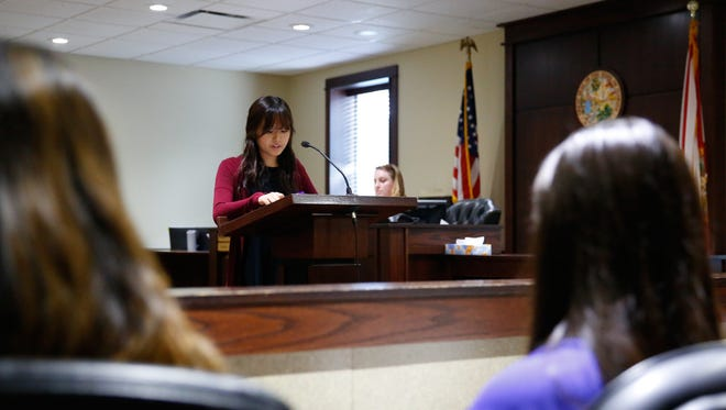Teen Court prosecutor Dakyung Ham prepares her team's argument to the jury at the Leon County Traffic Courthouse.