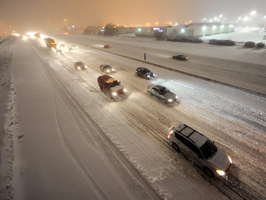 Being in the middle of traffic as the snow hits is not the time to wonder if you have the right tires for the season. Here's a look at the four basic types of tires. Pictured are vehicles moving slowly on eastbound I-465 as seen from the 82nd Street bridge as snow blanked the area, Tuesday, Feb. 4, 2014, in Indianapolis.