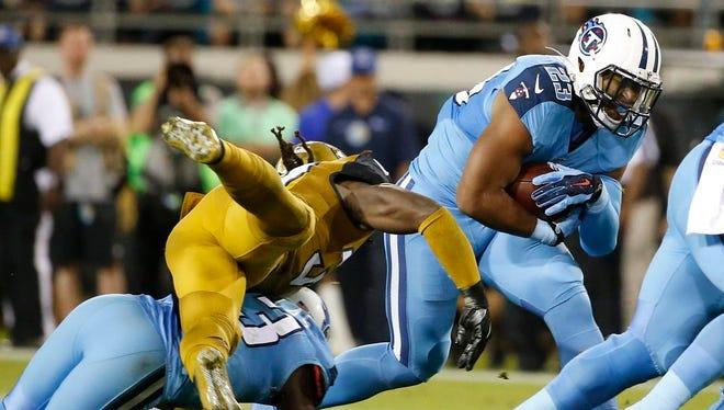Titans running back David Cobb (23) eludes Jaguars strong safety Johnathan Cyprien during the second quarter on Nov. 19 in Jacksonville.