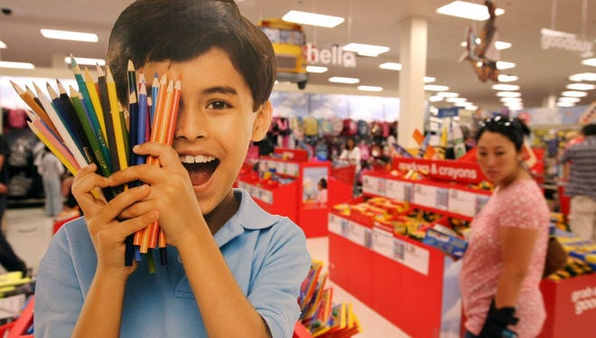 A Target customer shops for back to school supplies at a Target store in Daly City, California.