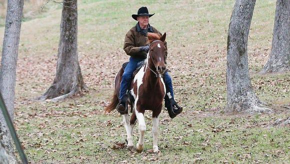 Roy Moore rides a horse to vote, Dec. 12, 2017, Gallant,