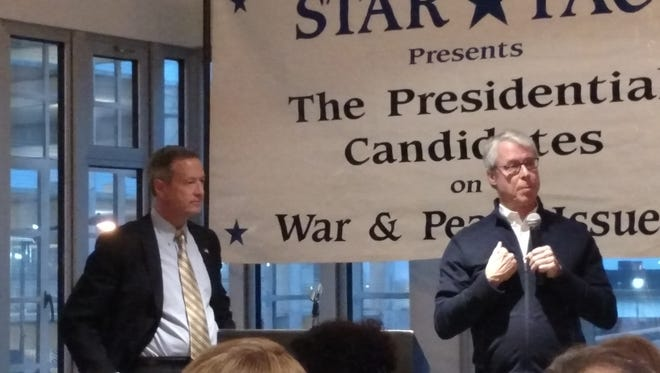 Democratic presidential candidate Martin O'Malley speaks with Des Moines Mayor Frank Cownie at a STAR PAC event Dec. 27.