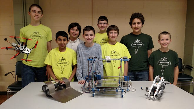 3D printing, drone (tethered) and VEX robot demonstrations are scheduled for the North County Branch Library Makers Day, by the Robostorm 4H Robotics Club, Drone Academy of Hunterdon and members of the Hunterdon Central FIRST Robotics Team. Pictured with technology they will be demonstrating are Danny Corbin, Ismail Mansuri, Chase Quijano, Bryce Blankinship, Mike Rowe, and Noah Rodgers from the Robostorm 4H Robotics Club.