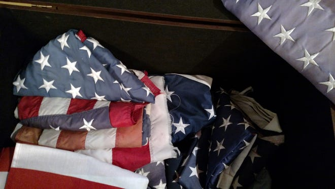 Old flags ready to be properly disposed of at the Sykes Funeral Home.