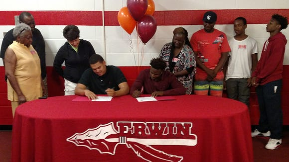 Erwin seniors Marc Peterson and Rayonte Mills signed to play college football for Maryville (Tenn.) on Friday.
