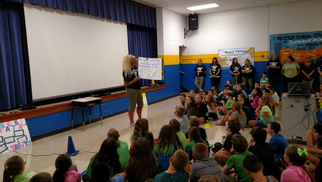 Michele Busler, Caroline L. Reutter School's Teacher of the Year, explains what it means to be respectful to the student body during the week of respect assembly.