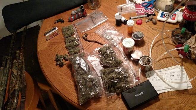 Medina police recovered marijuana, psychedelic mushrooms, drug paraphernalia and firearms Tuesday night at a Bryce Cove home.