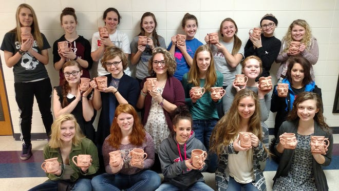 Merrill High School accelerated art students hand-sculpted ceramic mugs that will be auctioned off to support the school's food pantry.