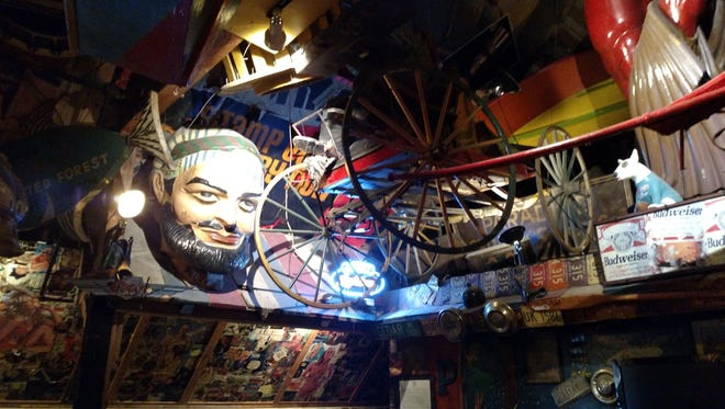 The ceiling at Minder Binders, a longtime Tempe and ASU hangout, featured a large head and wagon wheels before the items were stripped down to be auctioned. More than 500 kitschy and quirky pieces of memorabilia from the iconic landmark will be auctioned on Sept. 30, 2017, at a Glendale auction house.