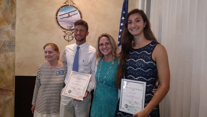 The Exchange Club of Vero Beach recently honored Lindsay Barkett, right, and Zachary Colton, second from left, as the Vero Beach High School students of the month.