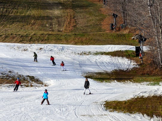 Skiers embrace the warm temperatures during the first weekend of the 2015-2016 ski season at Mount Snow Resort in West Dover, Vt. on Friday.