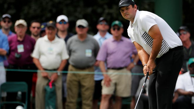 Patrick Reed putts on the sixth hole during the second round at the Masters golf tournament Friday, April 6, 2018, in Augusta, Ga. (AP Photo/David Goldman)