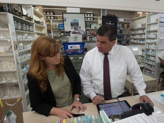 Karen Meyer, left, and Michael Lucas, right, members of the Walgreens management team prepare to take over operations at A&E Pharmacy on North New Warrington Road Thursday July 13, 2017. A&E will remain open under current ownership, only pharmacy operations has changed hands, said A&E Co-owner,David Infringer.