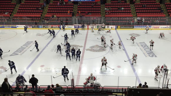 The Binghamton Senators, right, and St. John's IceCaps participate in warmups before Wednesday night's game.