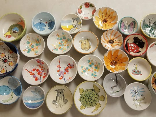 Examples of decorated bowls made for the soup luncheon of Empty Bowls Naples.