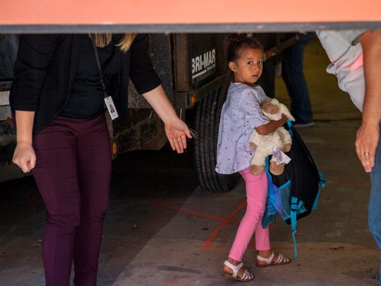 Children taken from their from parents are brought to the U.S. Immigration and Customs Enforcement (ICE) office building in Grand Rapids, Mich., to be reunited with family on Tuesday, July 10, 2018. More than 2,000 children were reportedly separated from their parents after crossing the Southern U.S. border as part of an immigration strategy by the Trump administration.