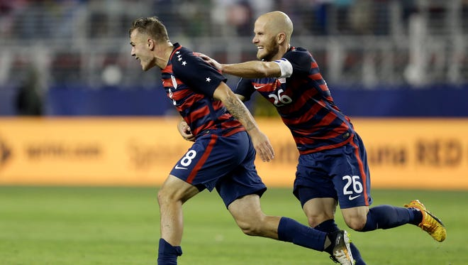 United States' Jordan Morris (left) and Michael Bradley celebrate after Morris scored a goal against Jamaica during the second half of the Gold Cup final soccer match on Wednesday.