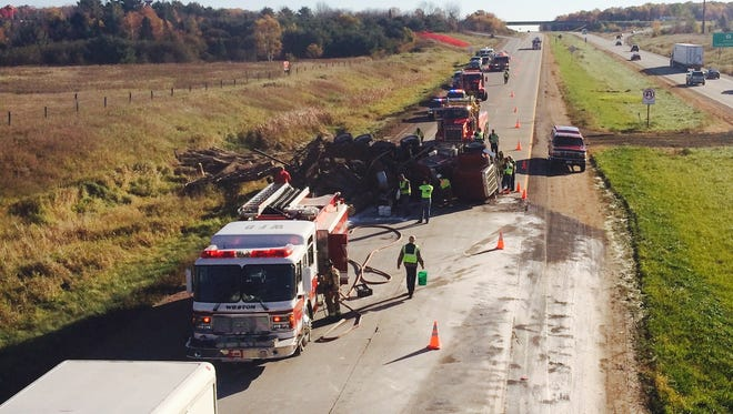 Emergency crews clean up after a log truck overturned on Highway 29 in Weston on Wednesday morning.