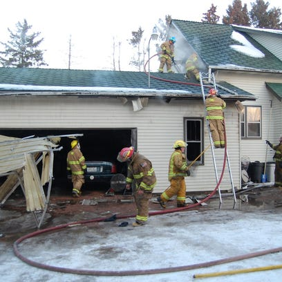 Firefighters worked to extinguish a fire in Chili on Monday, March 2, 2015.