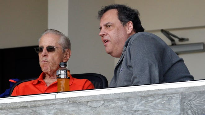 Gov. Chris Christie talks with New York Mets owner Fred Wilpon before the start of an exhibition spring training baseball game between the New York Mets and the New York Yankees Wednesday, March 9, 2016, in Port St. Lucie, Fla.
