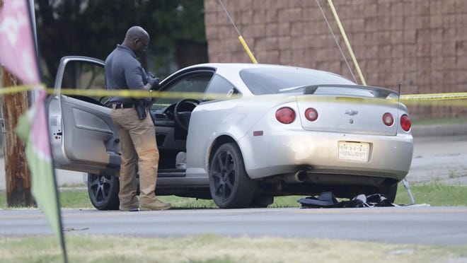 Officers investigate the scene of a shooting on South 89th East Avenue at 21st Street where two Tulsa Police officers were shot June 29, 2020.