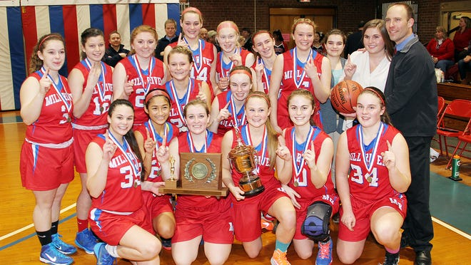 The Mill River girls basketball team poses with their school's first-ever girls basketball championship hardware following a 50-46 win over Lake Region in the Division II high school girls basketball state championship at Barre Auditorium on Saturday, Feb. 28, 2015. ever