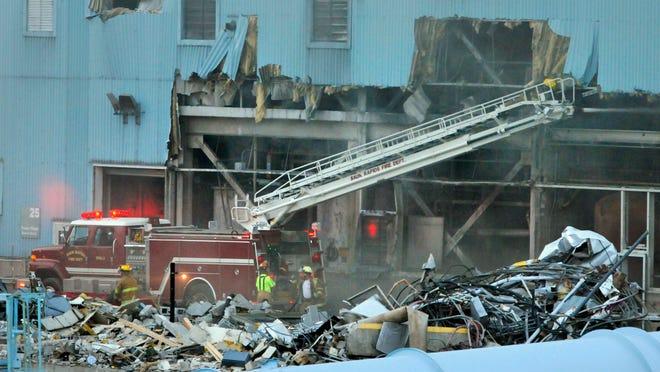 A Sauk Rapids Fire Department tower truck gets into position to help battle the fire.