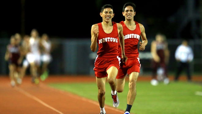 Robstown's Eugene Garza (left) passes teammate Christopher Munguia during last season's District 31-4A track meet. Garza won the 31-4A cross-country title on Thursday at Ingleside