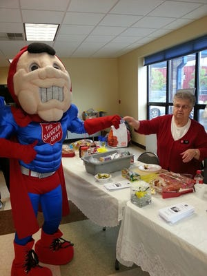 Salvation Army's Brown Bag Lunch Coordinator Barb Thill. Thill shares one of the season's first Brown Bag lunches with Captain Food keep up his energy during his special appearance at The Salvation Army's Open House May 11. Each lunch contains components contributed by community.