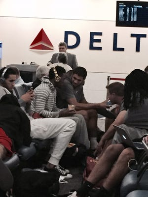 The Iowa State men's basketball team waits for its connecting flight in the Atlanta airport on Thursday.
