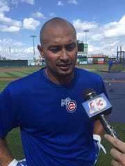 Iowa Cubs outfielder Shane Victorino meets with reporters