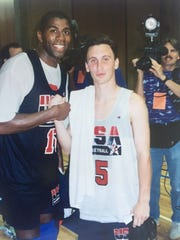 Duke point guard Bobby Hurley (right) with 1992 Dream Team member Magic Johnson during the Dream Team's training in San Diego.