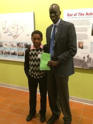 Stephen Holmes, a sixth grader at J.H. Williams Middle, meets Salva Dut, a noted humanitarian and activist for Sudan and Africa.
