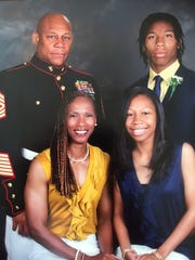 Re-al Mitchell, upper right, is pictured with his family, Rodney Mitchell, upper left, Sha-ri Pendleton-Mitchell, bottom left, and Yazmeen Mitchell, bottom right.