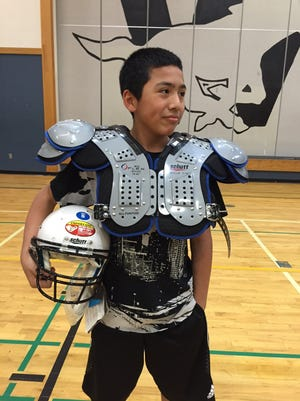 Christian Munguia, a 7th grade student at Waldo, sports some of the equipment donated by Law Enforcement for Youth.