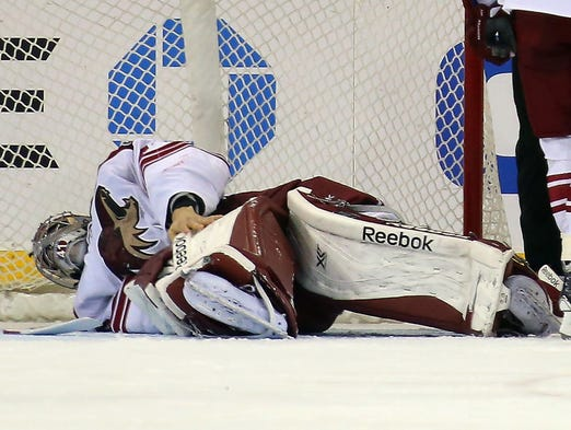Goaltender Mike Smith of the Phoenix Coyotes leaves the game against the New York Rangers after being injured in the third period at Madison Square Garden on March 24, 2014 in New York City. The Rangers defeated the Coyotes 4-3 in overtime.