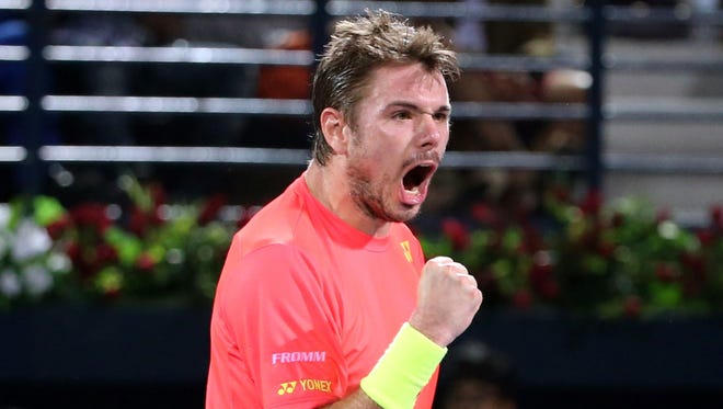 Stan Wawrinka celebrates after defeating Marcos Baghdatis.